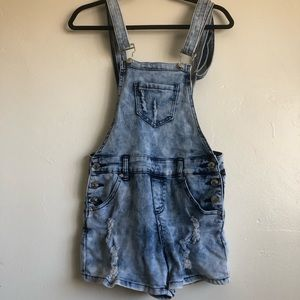 Lightwashed distressed denim overalls with pockets